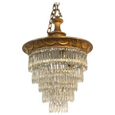 View this item and discover similar for sale at - Beautiful antique gilt bronze and crystal chandelier. Six tiers of gorgeous crystals. Very nice bronze gilt detail at the top of the chandelier. Baccarat Chandelier, Birdcage Chandelier, French Chandelier, Bronze Chandelier, Antique Chandelier, Antique Lighting, Chandelier Pendant Lights, Rustic Lighting, Dallas