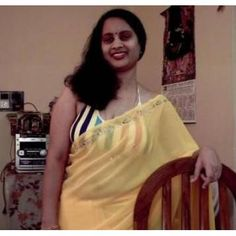 Tamil Aunty in Light Yellow Saree
