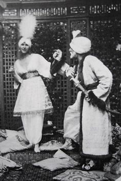 """Paul and Denise Poiret 1911 fancy ball. He was the Sultan and she appeared in a golden cage. After the party people began to call him """"The Sultan of Fashion""""."""
