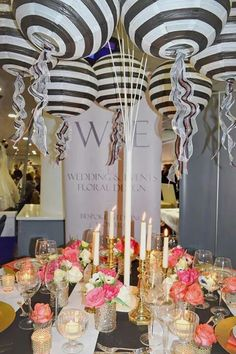 Black and White stripe Paper Lanterns hanging on our unique and fabulous  Multi Arm Tablestand centrepieces