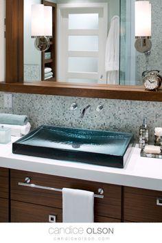 Glass Vessel Bathroom Sink • Blue Glass Sink • Antilia Wading Pool Glass Sink • Kohler Sink • Rectangle Sink • Wood Stained Cabinets • White Quartz Countertops • Micro Mosaic Tile Backsplash • #candiceolson #candiceolsondesign Glass Bathroom Sink, Glass Sink, Glass Vessel, Countertop Basin, Quartz Countertops, Marble Tiles, Mosaic Tiles, Kohler Sink, Candice Olson