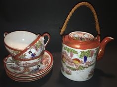 Japanese Geisha ware teapot with 3 tea cups and 4 saucers. Unmarked.