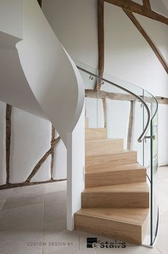 a circular stair with solid inner/glass outer balustrade