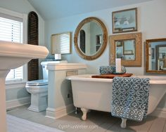 A wonderful vintage claw foot tub and my clients love of gilt mirrors framed the inspiration for this bathroom reno.