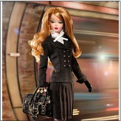 """GOLD LABEL """"Pretty Pleats"""" Barbie Doll ~ Silkstone GOLD LABEL """"Pretty Pleats"""" Barbie Doll   J0956 issued in 2006 as part of Barbie Fashion Model Collection (BFMC) made of heavier material called Silkstone. Black fishnet pantyhose/spectator pumps complete doll's ensemble. Additional accessories include black gloves, hoop earrings, a charm bracelet, sunglasses and fashionable black handbag.   Brand new in tissued box. Doll has never been removed from box. Box shows slight wear from shelf life…"""