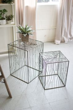 These minimalist accent tables use curved lines to mimic the natural beauty of…