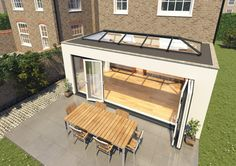 Flat roof extension with skylight & bifolding doors Orangery Roof, Conservatory Roof, Modern Conservatory, Garden Room Extensions, House Extensions, Kitchen Extensions, Orangerie Extension, Flat Roof Skylights, House Extension Design