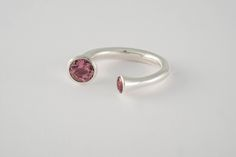 A Pink Tourmaline and Silver Double-Sided Ring, two beautiful soft round cut pink tourmalines, from Malawi with a combined weight of / grams, are mounted adjacent to each other in a rubover eco-silver setting. Diamond Bangle, Pink Tourmaline, Color Mixing, Birthstones, Designer Shoes, Flamingo, Silver Rings, Bangles, Gemstones