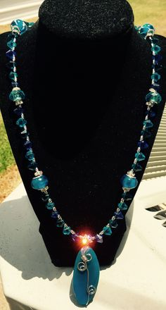 """Silver wrapped, dark turquoise """"Sea Glass"""" like pendant w/varying shades of blue beads, silver & rhinestone accents!!  $45/$55 w/matching earrings."""