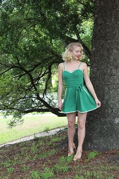 Get this look: http://lb.nu/look/8648125  More looks by Kayla J: http://lb.nu/gracefullyvintage  Items in this look:  Voodoo Vixen Jayne Playsuit, Revere Folie Daisy Chain Earrings   #classic #retro #vintage #playsuit #1950s #50s #pinup #spring #flowers