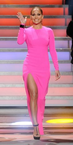 68c975c8ef Pin for Later  Jennifer Lopez s 71 Sexiest Styles Ever A glowing Jennifer  Lopez hit the Idol stage in a hot pink Michael Kors — with a thigh-high  slit.