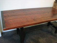 Dining table made from reclaimed wood and industrial metal parts