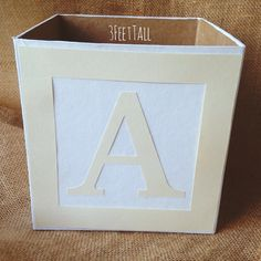 Finishing these pretty alphabet blocks for a baby shower tonight