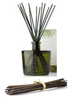 I make my own essential oil reed diffusers. It's simple.  All you need is a glass container with a narrow opening (to slow evaporation), 1/4 cup of a light oil like sweet almond or safflower oil, 15-20 drops essential oil, 2 Tbsp of alcohol to help oils travel up reeds (vodka works great), and reed sticks.  Flip sticks every few days to refresh scent. click photo (affiliate link) to get these great brown reed diffuser sticks