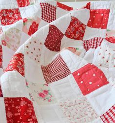 Red and white quilt. Stitched square within each square by Helen Phillips.