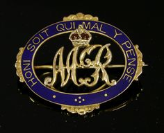 Of royal interest: a cased gold and enamel brooch, with the cypher of Queen Mary II of Great Britain, with a crown above decorated with red enamel to an oval garter frame, royal blue enamel decoration with the motto 'Honi. Soit. Qui. Mal. Y. Pense', in a fitted case by Plante, 12 Bury St, London SW. By repute given to Miss Jean Harkness, second personal housemaid to Queen Mary, 1935, Coronation 1937, Coronation 1953, by Queen Mary, tested as approximately 9ct gold £200-400 on 11th July 2017