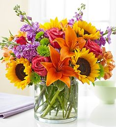 Embrace the #summer with this vibrant arrangement of #roses, #lilies, #sunflowers and other beautiful flowers!