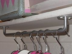 Hang Towel Rods Upside Down To Use As Unexpected Hanging Storage Dirtbike And Snowmobile Gear
