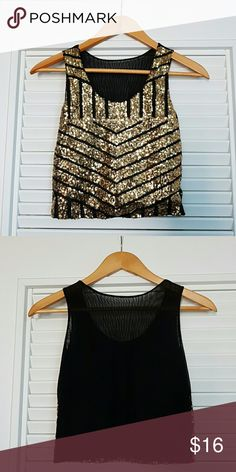 """Gold Sequin Chevron Sleeveless Top NWOT. Size SMALL fits TTS. Measures 14.5"""" pit to pit by 16.5"""" long. Has a lot of stretch.  Lined with a sheer sexy back. Boutique Tops Tank Tops"""