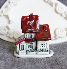 Polymer clay  NOTE: Create an exact replicate of someone's home out of clay, makes a very nice gift close to the heart.