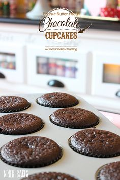 chocolate cupcakes with peanut butter filling and marshmallow frosting - 7 minute frosting - by niner bakes