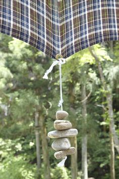 DIY: Rock Weights for a Sun Shade Gardenista... wouldn't this be cool with some fun and funky fabric?