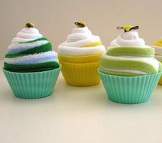 Cupcakes Each batch of these 'cupcakes' are made fresh to order. The set you see here are made using 4 baby washcloths, 2 pairs of socks and 4 silicone baking cups.