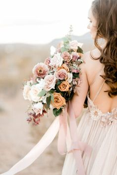 Dreamy wedding bouquet in cream, peach, dusty pink, blush and orange, wrapped in elegant ribbon. Click to see more of this Romantic, Intimate Desert Wedding in Las Vegas #desertwedding #wedding #outdoorwedding #nevadawedding #lasvegaswedding #romanticwedding #fineartwedding #weddingtheme #weddingideas #confettidaydreams #neutralwedding #blushwedding Fall Wedding Flowers, Bridal Flowers, Spring Wedding, Floral Wedding, Pink Flowers, Las Vegas, Blush Bouquet, Photo Couple, Bride Bouquets