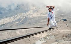 """Swiss stuntman Freddy Nock has just climbed Germany's highest mountain by tightrope walking up it's 1,000-meter-long cable car cable, which took an hour and 20 minutes.  He plans to submit his feat for entry in the Guinness Book of Records as the """"longest and highest wire walk above sea level without a balancing pole"""".  Check out watch the video of part of his ascent."""