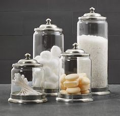 APOTHECARY PEWTER & GLASS BATH JARS  With their pewter bases and lids, our glass jars have the character of vintage apothecary and medicine-cabinet vessels. The snug lift-off lids keep the contents free of moisture and dust.  Restoration Hardware