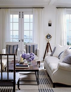 white, paneled walls, beamed ceiling, double french doors with great hardware