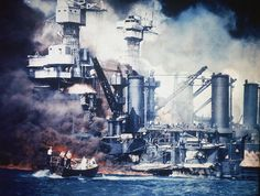 Sailors in a motor launch rescued a survivor from the water alongside the sunken West Virginia during or shortly after the Japanese air raid on Pearl Harbor, 7 Dec 1941, photo 2 of 2; note false color