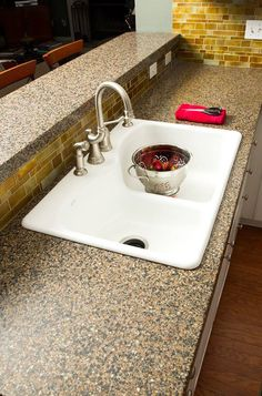 Over-mounted kitchen sink. Granite counter-top and tile backsplash by Granite Transformations.