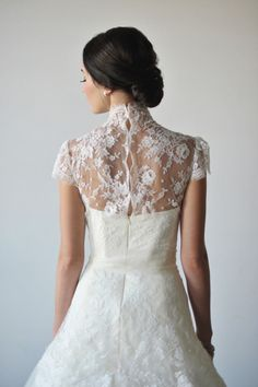 High-neck lace gown: http://www.stylemepretty.com/2013/01/04/bridal-ballet-inspiration-shoot-from-attention-2-detail-events/   Photography: Rebekah Westover - http://rebekahwestover.com/