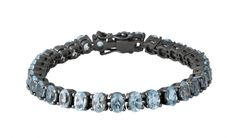 Cool armbånd i sort sølv med blå topas