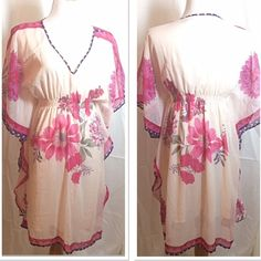 Beautiful dolman sleeve floral print dress Such a gorgeous girly dress and so flowy and lightweight. Gently used Speed Control Dresses