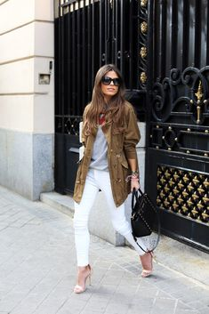 55 Spring Outfits to Copy ASAP | White skinny jeans styled with a chic silk scarf, olive anorak jacket, and dainty nude heels