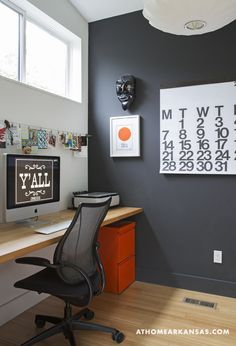 In Trisha's home office, a slim butcher-block top by IKEA stands in for a desk. The crisp black-and-white palette serves as a canvas for the graphic designer's revolving curation of artwork and other articles of inspiration.