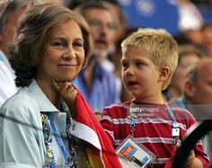 Queen Sofia of  Spain is tickled by her grandson Juan while watching Spain play Germany in the men's handball quarter-final clash at the…