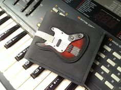 Limited Edition Men Wallet Fender Bass Guitar & Sunburst Color leather $35.00 USD Only 1 available Overview Handmade item M...