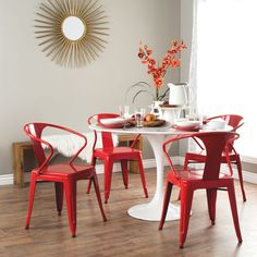 These stacking chairs come in a red color option and have a sturdy steel construction. The polished finish on this set of four chairs is both mar and scratch resistant.
