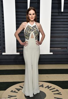 Chic:Michelle Dockery, 35, had no trouble taking centre-stage once again as she stormed the Vanity Fair Oscar party in Beverly Hills on Sunday night