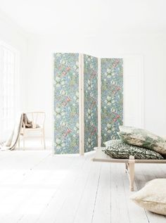 This folding screen was made from IVAR parts and a little bit of William Morris pattern fabric by Mokkasin and can be used anywhere you want to hide clutter. || Inventive Ways to Use IKEA's IVAR All Over the House