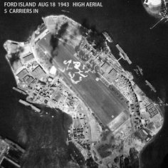Ford Island, Pearl Harbor, August, 1943. Five carriers in view. Also not the strange attempt at camouflage on the airfield.