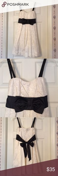Speechless dress Beautiful cream patterned dress with black satin straps, waist, bow on front and back sash!!  Has crinoline slip attached underneath  Speechless Dresses