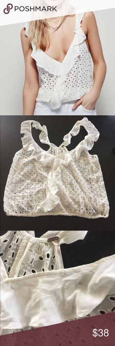 Free People eyelet top Free People soulshine eyelet flounce top, size large.  Cute cropped oversized fit with elastic waist.  100% rayon.  Off white color.  Purchased as new but looks like it has been worn/washed, priced accordingly.  Model pics from Pinterest to show fit. Free People Tops Crop Tops