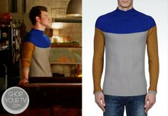 Kurt Hummel (Chris Colfer) wears this color block wool sweater in this week's episode of Glee.
