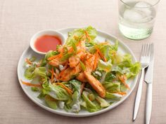 By making her own sauce and dressing, Ellie Krieger packs all the Buffalo kick and creaminess of blue cheese in this restaurant-favorite Buffalo Chicken Salad.