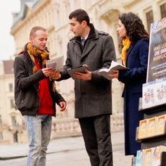 Two of Jehovah's Witnesses in a metropolitan area make information available to the public free of charge