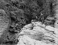Great Rock, brink of lower fall, from which 39 was made.  Watrous, Doyle, and J.V.B. on rock. Oct, 1909 Frank W. Bicknell Photograph Collection, PhC.8, North Carolina State Archives, Raleigh, NC.